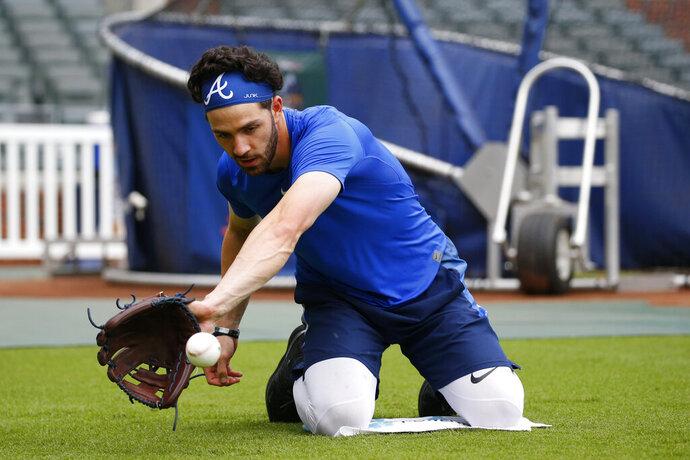 Atlanta Braves shortstop Dansby Swanson works on his fielding skills before a baseball game against the Cincinnati Reds Thursday, Aug. 1, 2019, in Atlanta. (AP Photo/John Bazemore)