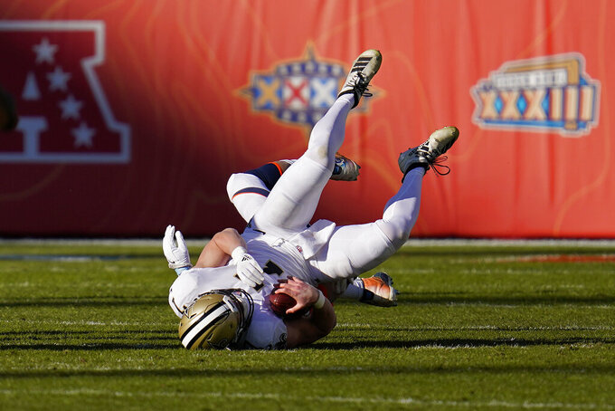 New Orleans Saints quarterback Taysom Hill is sacked during the first half of an NFL football game against the Denver Broncos, Sunday, Nov. 29, 2020, in Denver. (AP Photo/David Zalubowski)
