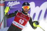 Luke Winters, of the United States, arrives at the finish area of an alpine ski, men's World Cup slalom in Val d' Isere, France, Sunday, Dec. 15, 2019. (AP Photo/Marco Trovati)