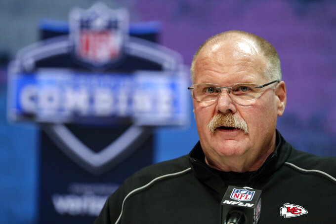FILE - In this Feb. 25, 2020, file photo, Kansas City Chiefs head coach Andy Reid speaks during a press conference at the NFL football scouting combine in Indianapolis. More than half of the 32 NFL teams will not have their coaching staffs back at their facilities Friday. June 5, 2020, even though the league has approved such returns where local governments allow them. Clubs with coaches in place at their training complexes were Super Bowl champion Kansas City, Pittsburgh, Cincinnati, Cleveland, Houston, Denver, Dallas and Atlanta.(AP Photo/Michael Conroy, File)