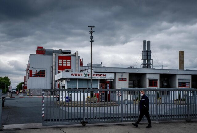 The Westfleisch slaughterhouse is seen in Coesfeld, Germany, Tuesday, May 12, 2020. Hundreds of the workers were tested positive on the coronavirus and were put on quarantine. (AP Photo/Michael Probst)