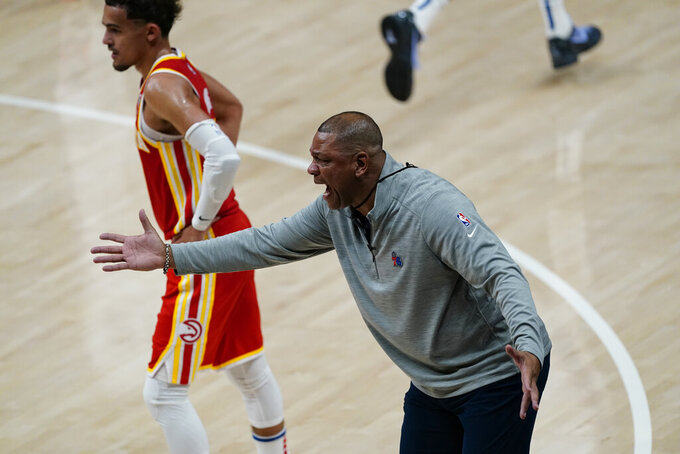 Philadelphia 76ers head coach Doc Rivers, right, reacts during the first half of Game 3 of a second-round NBA basketball playoff series against the Atlanta Hawks, Friday, June 11, 2021, in Atlanta. (AP Photo/John Bazemore)