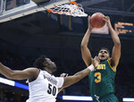 FILE- In this March 16, 2017, file photo Vermont's Anthony Lamb grabs a rebound in front of Purdue's Caleb Swanigan during the first half of an NCAA college basketball tournament first round game in Milwaukee. (AP Photo/Kiichiro Sato, File)