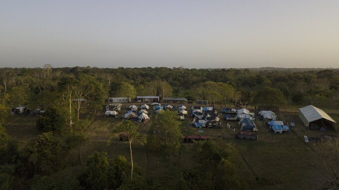 Tents stand at a migrant camp amid the new coronavirus pandemic in San Vicente, Darien province, Panama, Tuesday, Feb. 9, 2021. Panama is allowing hundreds of migrants stranded because of the pandemic, to move to the border with Costa Rica, after just reopening its land borders. (AP Photo/Arnulfo Franco)