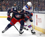 Columbus Blue Jackets' Sonny Milano, left, and New York Rangers' Brett Howden vie for the puck during the third period of an NHL hockey game Thursday, Dec. 5, 2019, in Columbus, Ohio. The Rangers beat the Blue Jackets 3-2. (AP Photo/Jay LaPrete)