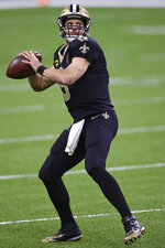 New Orleans Saints quarterback Drew Brees (9) throws the football during warm-ups in an NFL game against the San Francisco 49ers, Sunday, Nov. 15, 2020 in New Orleans. The Saints defeated the 49ers 27-13. (Margaret Bowles via AP)