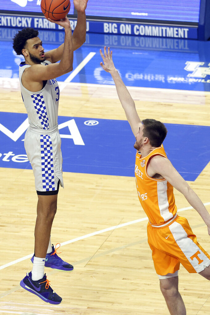 Kentucky's Olivier Sarr, left, shoots while defended by Tennessee's John Fulkerson during the second half of an NCAA college basketball game in Lexington, Ky., Saturday, Feb. 6, 2021. (AP Photo/James Crisp)