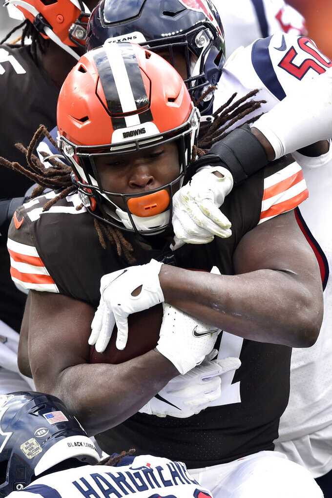 Cleveland Browns running back Kareem Hunt (27) is tackled after a 3-yard gain during the first half of an NFL football game against the Houston Texans, Sunday, Nov. 15, 2020, in Cleveland. (AP Photo/David Richard)