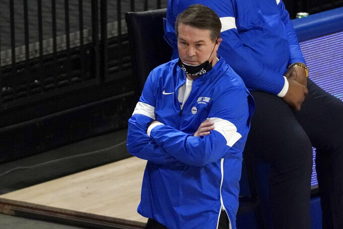 Saint Louis head coach Travis Ford is seen on the sidelines during the first half of an NCAA college basketball game against the Dayton Tuesday, Jan. 26, 2021, in St. Louis. (AP Photo/Jeff Roberson)