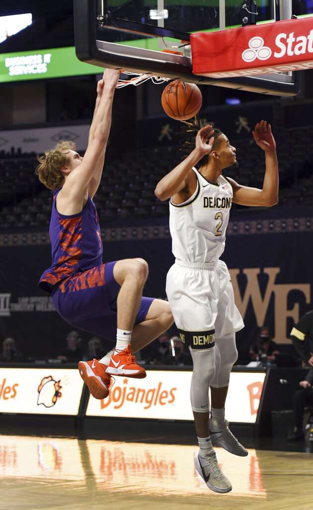 Clemson's Hunter Tyson dunks the ball over Wake Forest's Jalen Johnson during the first half of an NCAA college basketball game, Wednesday, Feb. 24, 2021 at Joel Coliseum in Winston-Salem, N.C. (Walt Unks/The Winston-Salem Journal via AP, Pool)