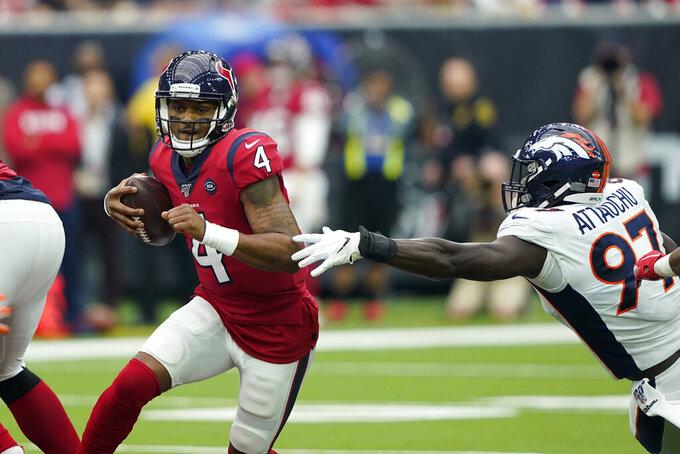 Houston Texans quarterback Deshaun Watson (4) is pressured by Denver Broncos linebacker Jeremiah Attaochu (97) during the first half of an NFL football game Sunday, Dec. 8, 2019, in Houston. (AP Photo/David J. Phillip)