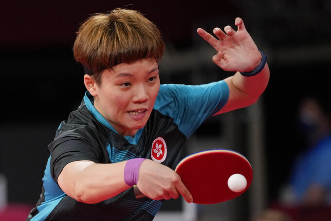 Hong Kong's Doo Hoi-kem competes during the table tennis women's singles round of 16 match against Neverland's Britt Eerland at the 2020 Summer Olympics, Tuesday, July 27, 2021, in Tokyo. (AP Photo/Kin Cheung)