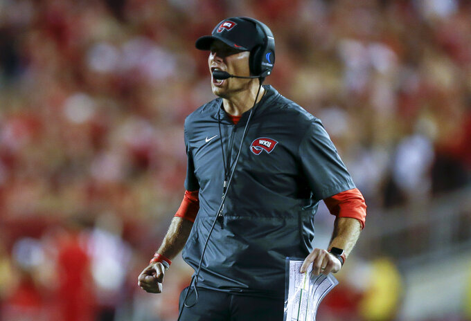 Western Kentucky coach Mike Sanford disputes a call during the second half of an NCAA college football game against Wisconsin on Friday, Aug. 31, 2018, in Madison, Wis. Wisconsin won 34-3. (AP Photo/Andy Manis)