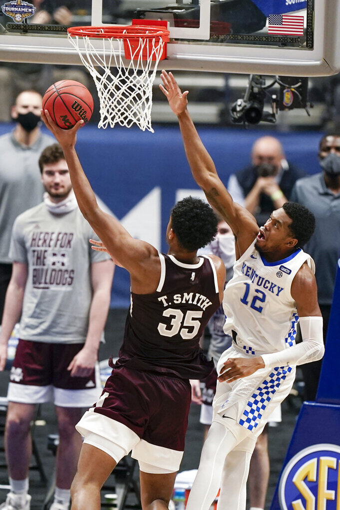 Mississippi State's Tolu Smith (35) shoots against Kentucky's Keion Brooks Jr. (12) in the second half of an NCAA college basketball game in the Southeastern Conference Tournament Thursday, March 11, 2021, in Nashville, Tenn. (AP Photo/Mark Humphrey)