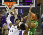 Washington forward Noah Dickerson (15) battles with Oregon forward Francis Okoro, right, for a rebound during the first half of an NCAA college basketball game, Saturday, March 9, 2019, in Seattle. (AP Photo/Ted S. Warren)