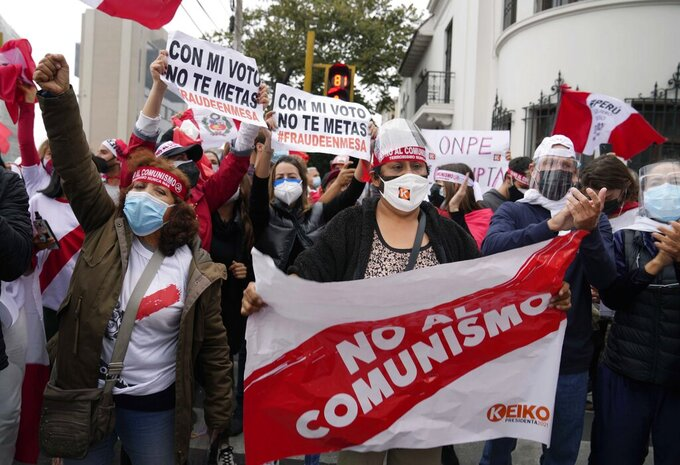Supporters of presidential candidate Keiko Fujimori protest alleged election fraud, outside the site where the votes are being counted, in Lima, Peru, Tuesday, June 8, 2021, two days after the presidential runoff between Fujimori and rival candidate Pedro Castillo. (AP Photo/Martin Mejia)