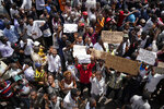 Supporters of spurned Congo opposition candidate Martin Fayulu holds placards reading