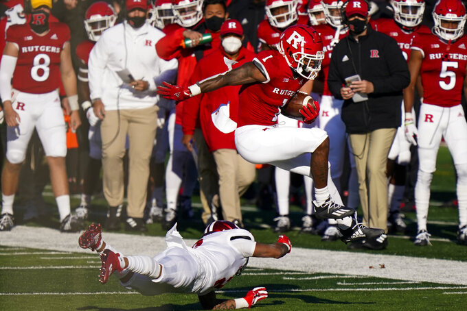 Rutgers running back Isaih Pacheco (1) jumps over Indiana defensive back Reese Taylor in the first quarter of an NCAA college football game, Saturday, Oct. 31, 2020, in Piscataway, N.J. (AP Photo/Corey Sipkin)