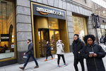 People walk by an Amazon bookstore, Thursday, Feb. 14, 2019, in New York. Amazon will not build a new headquarters in New York City, a stunning reversal to an ambitious plan that would have brought an estimated 25,000 jobs to the city. (AP Photo/Mark Lennihan)