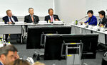Tokyo Governor Yuriko Koike, second from right, speaks as top IOC official John Coates, left, listens to her during their meeting in Tokyo Wednesday, Oct. 30, 2019.  Tokyo Governor Koike has told powerful IOC members she wants the Olympic marathon held in Tokyo and lashed out at what she called an