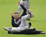 Atlanta Braves first baseman Freddie Freeman practices his sliding technique using the new sliding matts on the team's agility field during spring training on Friday, Feb. 21, 2020, in North Port, Fla. (Curtis Compton/Atlanta Journal-Constitution via AP)
