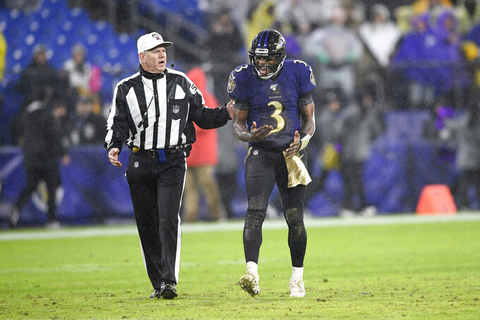 Baltimore Ravens quarterback Robert Griffin III (3) reacts while talking to referee Bill Vinovich (52) during the second half of an NFL football game against the Pittsburgh Steelers, Sunday, Dec. 29, 2019, in Baltimore. The Ravens won 28-10. (AP Photo/Nick Wass)