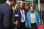 Juanita White, mother of Michael White, exits the Stout Center for Criminal Justice, Thursday, Oct. 17, 2019, in Philadelphia, after a jury found her son not guilty in the stabbing death of Sean Schellenger in the Rittenhouse section of the city last July. (Heather Khalifa/The Philadelphia Inquirer via AP)