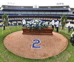In this photo provided by the Los Angeles Dodgers, the casket of former Los Angeles Dodgers manager Tommy Lasorda rests on the mound at Dodger Stadium on Tuesday, Jan. 19, 2021, in Los Angeles. Lasorda was memorialized during a private service at the stadium before his burial. The Hall of Fame manager died Jan. 7 after a heart attack at age 93. (John SooHoo/Los Angeles Dodgers via AP)