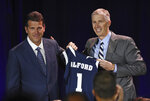 Athletic director Doug Knuth, right, introduces Steve Alford, left, as the new Nevada basketball coach during a news conference in Reno, Nev., Friday, April 12, 2019. Alford said he is hungry for the chance to take the Wolf Pack to the next level. (Andy Barron/Reno Gazette-Journal via AP)