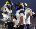 California quarterback Chase Garbers, left, celebrates with right guard Ryan Gibson after scoring a touchdown during the second half of an NCAA college football game against Southern California in Los Angeles, Saturday, Nov. 10, 2018. California won 15-14. (AP Photo/Alex Gallardo)