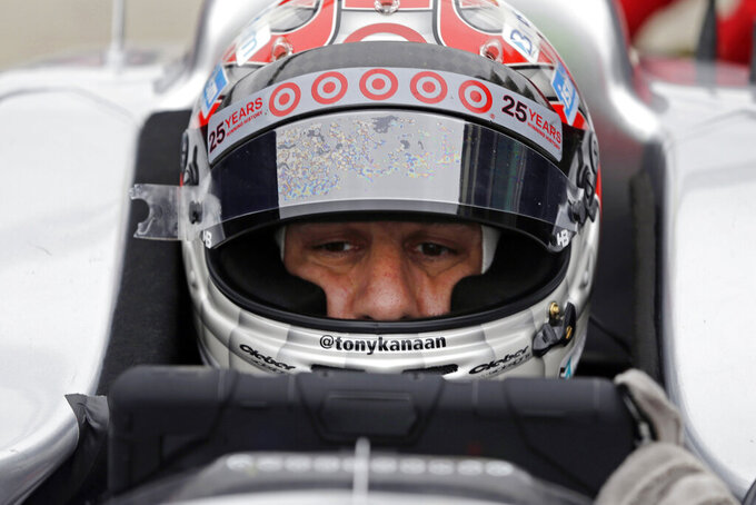 "FILE - In this May 14, 2014, file photo, Tony Kanaan of Brazil, checks racing data as he waits in the pits during practice for the Indianapolis 500 IndyCar auto race at the Indianapolis Motor Speedway in Indianapolis. Kanaan will get to race 5 oval events, including the Indianapolis 500, in what will be called his ""farewell tour"" this upcoming IndyCar season. (AP Photo/Darron Cummings, File)"