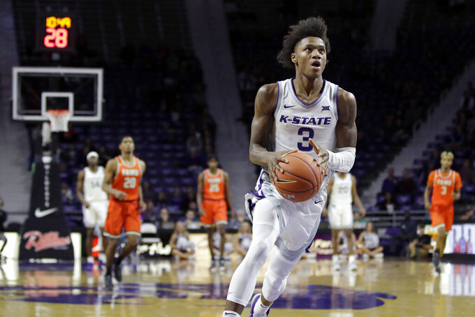 Kansas State's DaJuan Gordon (3) drives to the basket during the first half of an NCAA college basketball game against Florida A&M, Monday, Dec. 2, 2019, in Manhattan, Kan. (AP Photo/Charlie Riedel)
