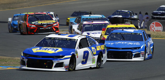 Chase Elliott (9) leads through a turn as he competes during a NASCAR Sprint Cup Series auto race Sunday, June 23, 2019, in Sonoma, Calif. (AP Photo/Ben Margot)