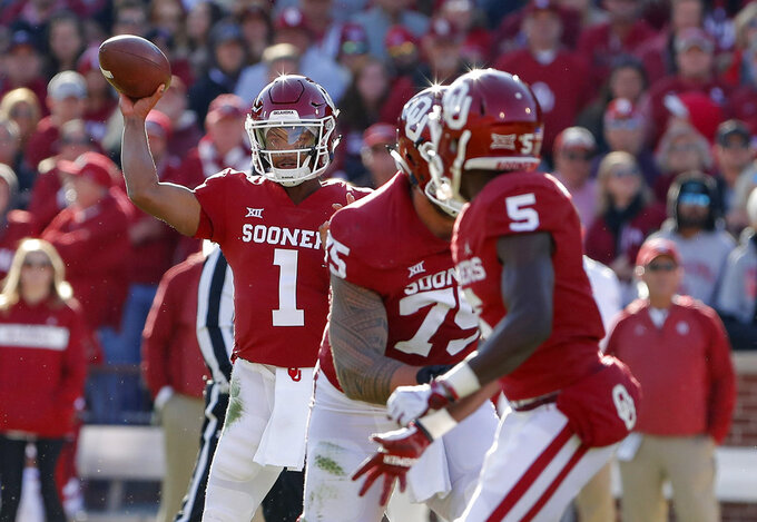Oklahoma quarterback Kyler Murray (1) passes against Oklahoma State in the first quarter of an NCAA college football game in Norman, Okla., Saturday, Nov. 10, 2018. (AP Photo/Alonzo Adams)