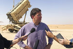 FILE - In this Oct. 22, 2019, file photo, then-U.S. Defense Secretary Mark Esper talks to reporters at Prince Sultan Air Base in Saudi Arabia. The U.S. has removed its most advanced missile defense system and Patriot batteries from Saudi Arabia's Prince Sultan Air Base in recent weeks, even as the kingdom faced continued air attacks from Yemen's Houthi rebels, satellite photos analyzed by The Associated Press show. (AP Photo/Lolita Baldor, File)