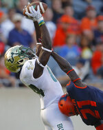 South Florida's Randall St. Felix, left, makes a catch over Illinois's Jartavius Martin during the second half of an NCAA college football game Saturday, Sept. 15, 2018, in Chicago. (AP Photo/Jim Young)