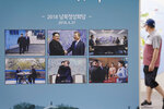 """Photos from the April 27, 2018, inter-Korean summit between South Korean President Moon Jae-in and North Korean leader Kim Jong Un are displayed at the Unification Observation Post in Paju, South Korea, near the border with North Korea, Sunday, Sept. 26, 2021. The powerful sister of North Korean leader Kim Jong Un said Saturday that her country will take steps to repair ties with South Korea, and may even discuss another summit between their leaders, if the South drops what she described as hostility and double standards. Korean letters read: """" 2018 summit between the South and North Korea."""" (AP Photo/Ahn Young-joon)"""