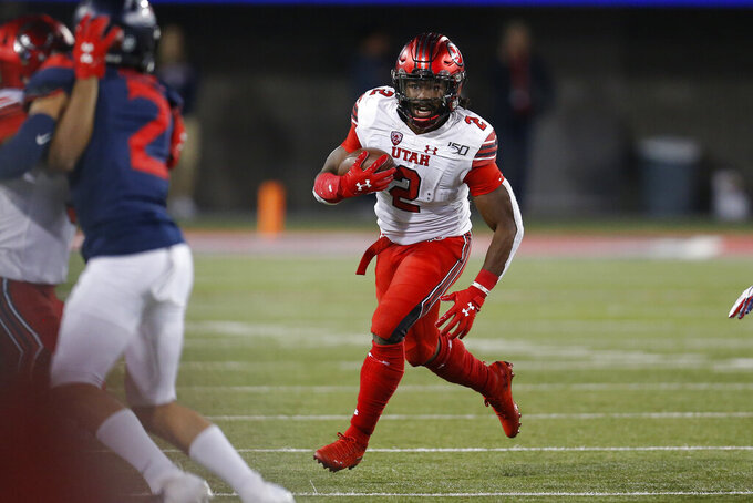 Utah running back Zack Moss (2) scores a touchdown against Arizona during the second half during an NCAA college football game, Saturday, Nov. 23, 2019, in Tucson, Ariz. (AP Photo/Rick Scuteri)
