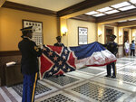 Honor guard members from the Mississippi National Guard practice folding the former Mississippi flag before a ceremony to retire the banner on Wednesday, July 1, 2020, inside the state Capitol in Jackson. The ceremony happened a day after Republican Gov. Tate Reeves signed a law that removed the flag's official status as a state symbol. The 126-year-old banner was the last state flag in the U.S. with the Confederate battle emblem. (AP Photo/Emily Wagster Pettus)
