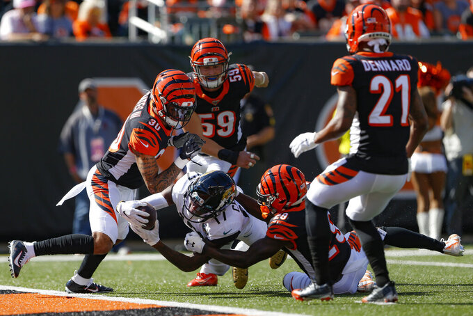 Jacksonville Jaguars wide receiver D.J. Chark (17) dives for extra yardage against Cincinnati Bengals cornerback Tony McRae (29) in the first half of an NFL football game, Sunday, Oct. 20, 2019, in Cincinnati. (AP Photo/Gary Landers)