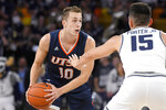UTSA guard Erik Czumbel (10) looks to dribble the ball as Utah State guard Abel Porter (15) defends during the first half of an NCAA college basketball game Monday, Nov. 18, 2019, in Logan, Utah. (AP Photo/Eli Lucero)