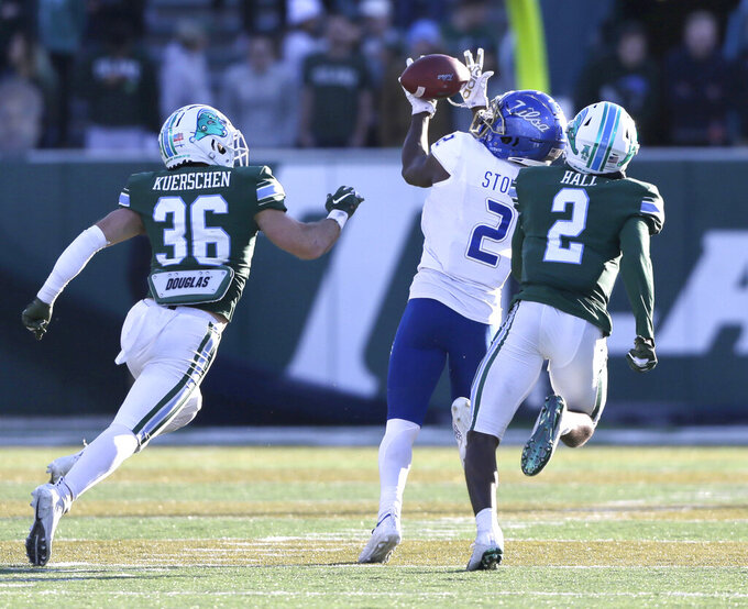 Tulsa wide receiver Keylon Stokes, center, snags a pass in front of Tulane safety Chase Kuerschen (36) and safety P.J. Hall, right, during an NCAA college football game in New Orleans, La., Saturday, Nov. 2, 2019. (A.J. Sisco/The Advocate via AP)