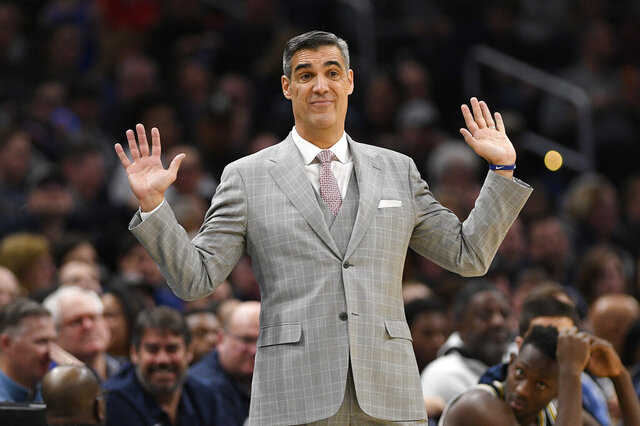 FILE - In this March 7, 2020, file photo, Villanova head coach Jay Wright gestures during the second half of an NCAA college basketball game against Georgetown in Washington. Two-time Villanova national champion coach Jay Wright says it's