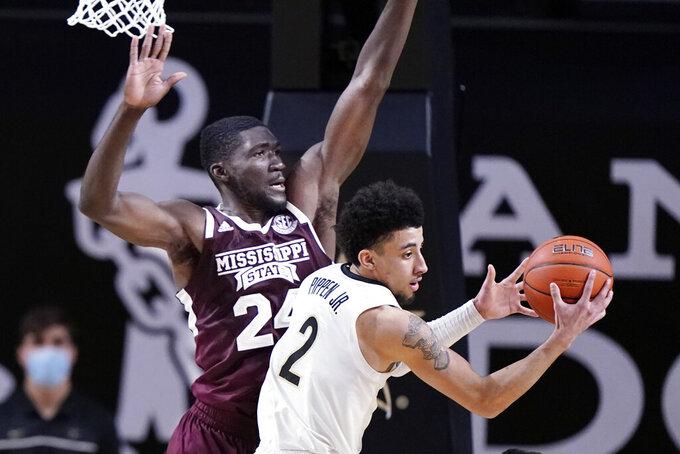 Mississippi State forward Abdul Ado (24) blocks the path of Vanderbilt guard Scotty Pippen Jr. (2) in the second half of an NCAA college basketball game Saturday, Jan. 9, 2021, in Nashville, Tenn. (AP Photo/Mark Humphrey)