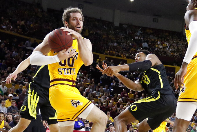 Arizona State's Mickey Mitchell (00) wins a loose ball against Oregon's Chandler Lawson (13) during the first half of an NCAA college basketball game Thursday, Feb. 20, 2020, in Tempe, Ariz. (AP Photo/Darryl Webb)