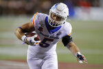 Boise State Broncos' Garrett Collingham (5) runs in for a touchdown against UNLV during the first half of an NCAA college football game Saturday, Oct. 5, 2019, in Las Vegas. (AP Photo/John Locher)