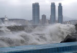 High waves crash a shore as Typhoon Haishen approaches in Busan, South Korea, Monday, Sept. 7, 2020. The powerful typhoon damaged buildings, flooded roads and knocked out power to thousands of homes in South Korea on Monday after battering islands in southern Japan. More than 20 people were injured.(Son Hyung-ju/Yonhap via AP)