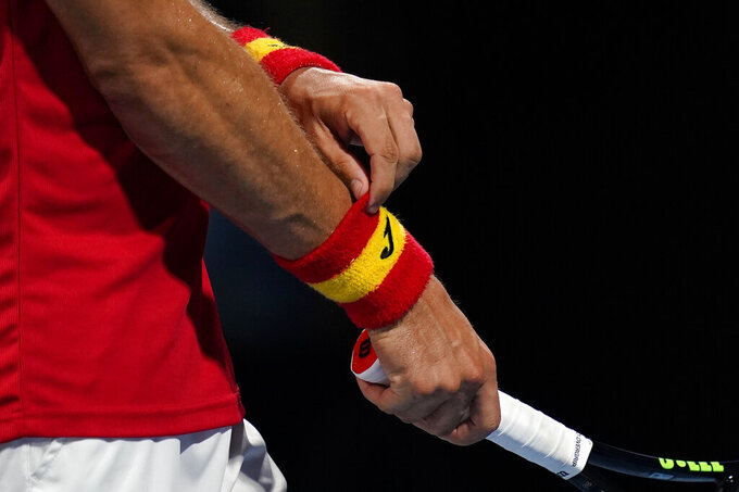 Pablo Carreno Busta, of Spain, adjusts his wristbands during a quarterfinal men's tennis match against Daniil Medvedev, of the Russian Olympic Committee, at the 2020 Summer Olympics, Thursday, July 29, 2021, in Tokyo, Japan. (AP Photo/Patrick Semansky)