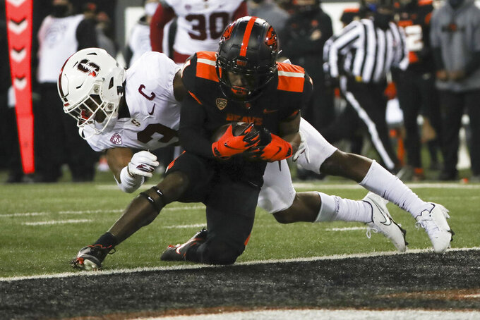 Oregon State wide receiver Tyjon Lindsey (1) runs past Stanford free safety Malik Antoine (3) to score a touchdown during the first half of an NCAA college football game in Corvallis, Ore., Saturday, Dec. 12, 2020. (AP Photo/Amanda Loman)