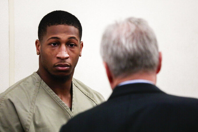 Former Ohio State Buckeyes football player Amir Riep consults with his attorney, Karl Schneider, right, during his arraignment on Thursday, Feb. 13, 2020, at the Franklin County Municipal Courthouse in Columbus, Ohio. Riep, who was dismissed from the team on Feb. 12, 2020 ,along with teammate and co-defendant Jahsen Wint, are charged with the rape and kidnapping of a 19-year-old woman on Feb. 4, 2020 at an apartment the two men share. (Joshua A. Bickel/The Columbus Dispatch via AP)